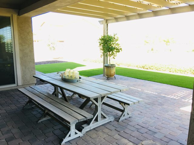 extended patio and upgraded artificial grass