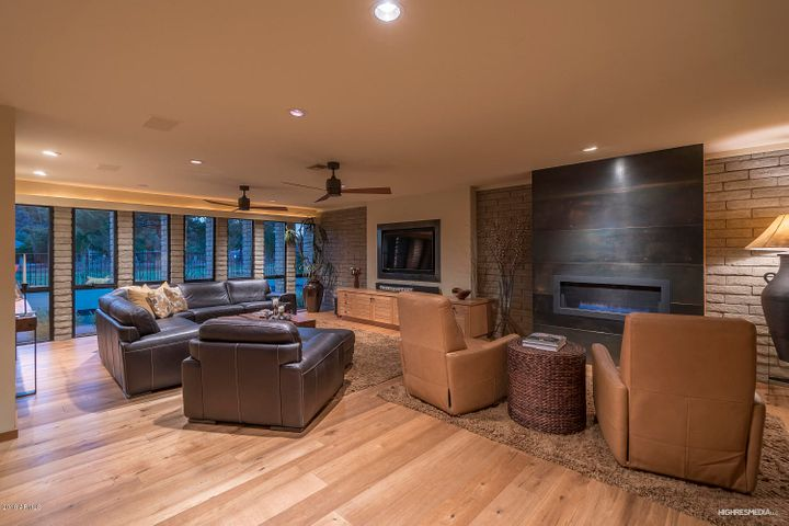 Great room boasts wall of windows to outdoor living & golf. Recent $15K A/V upgrade