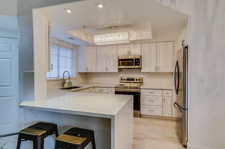 All new kitchen - cabinets, plumbing, electrical, appliances