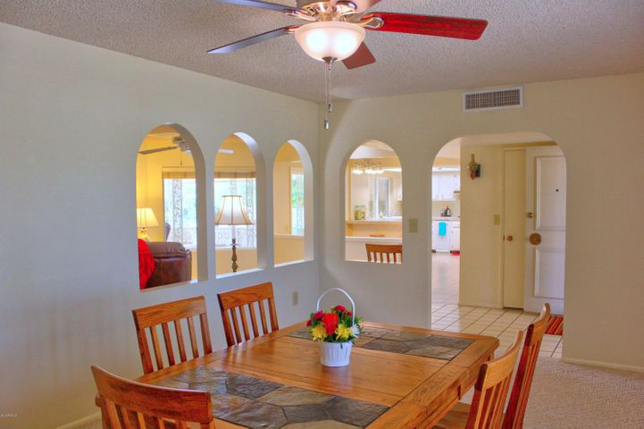 View from the dining room out through the rest of the home showing the open floor plan and unrestricted views