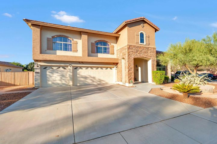 """You'll know you've """"Arrived"""" as soon as you pull up to this spacious home on an oversize corner lot."""