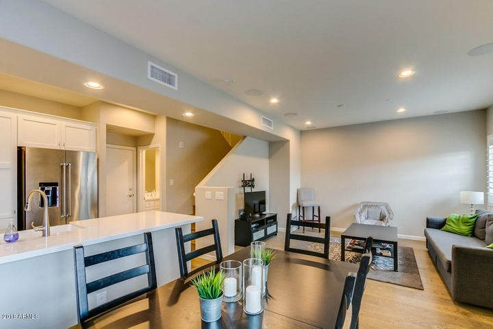 Open floorplan, beautiful quartz countertops & Kitchen Aid Appliances