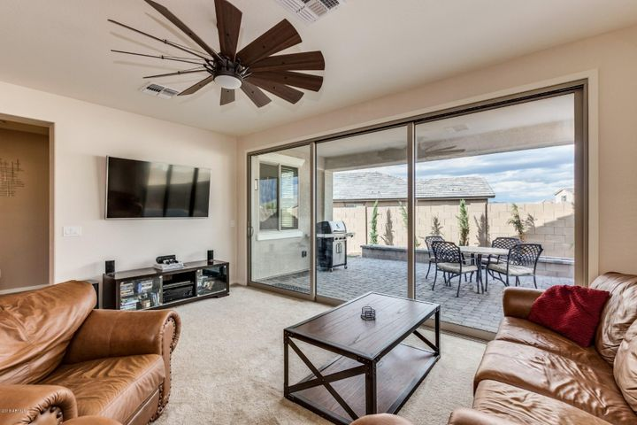 Great room with multi slide door, upgraded fan and lighting