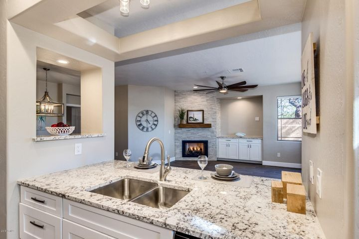 It's all in the details! Beautiful Granite, Fans, Light Fixtures, Cabinets, Flooring, even the Paint Color is Fantastic!
