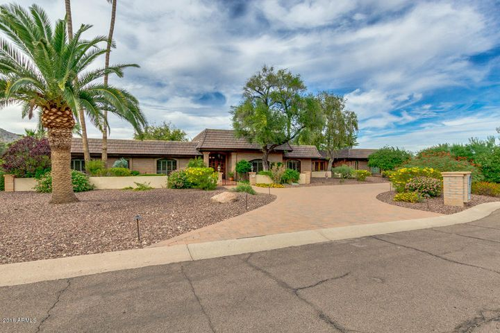 Nestled on over an acre lot in a quiet neighborhood of Vista Rica, Paradise Valley.
