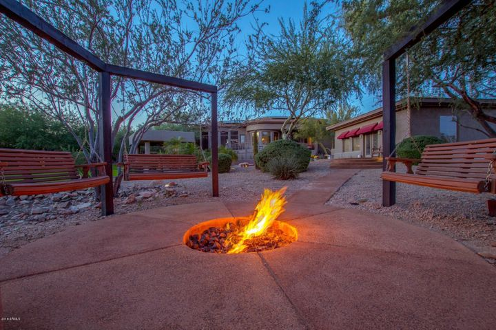 """Fire Pit and """"adult swing set"""" which features four 3-person bench swings"""