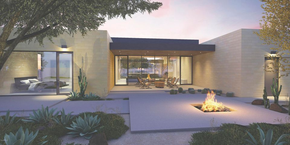 View from the outdoor patio, aft of the living/dining room. Natural desert landscaping are throughout the community.