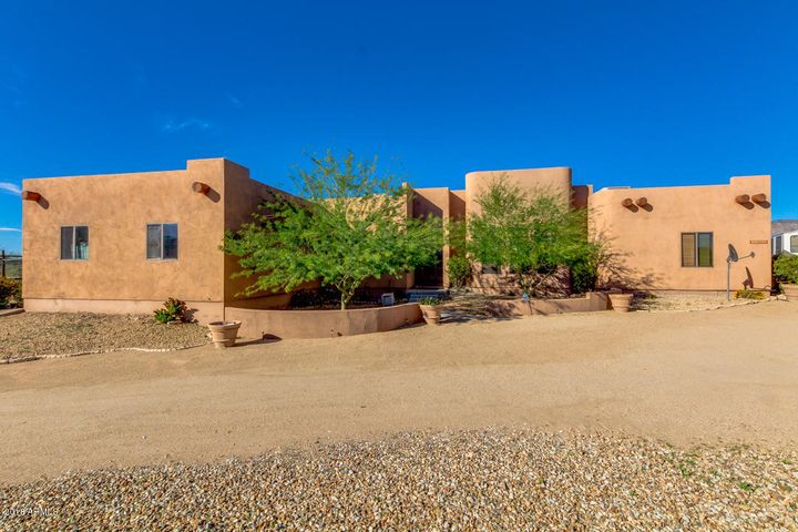 Immaculately maintained Santa Fe/Territorial Home on 1 acre.