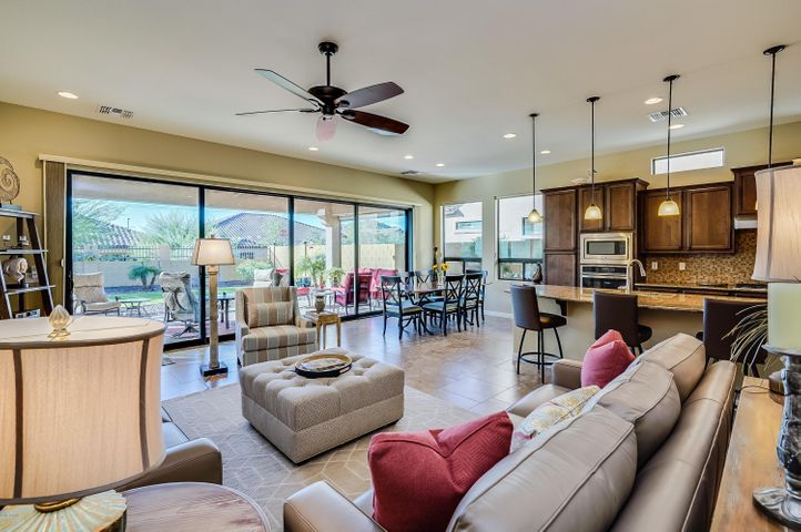 Blandford's Residence One model. Popular open floor plan. Great Room, Kitchen & Wall of Glass