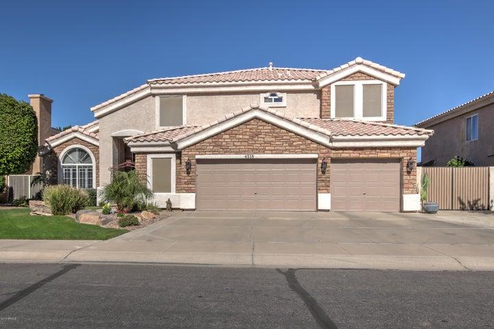 Beautiful Stone front, professionally landscaped, 3 car garage & RV Gate!
