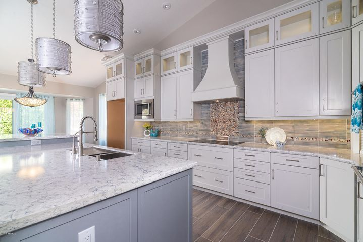 New kitchen includes new SS appliances, new endless cabinetry, new slab Quartz, new LED lighting above and below cabinets, new custom range hood and custom tiles backsplash.