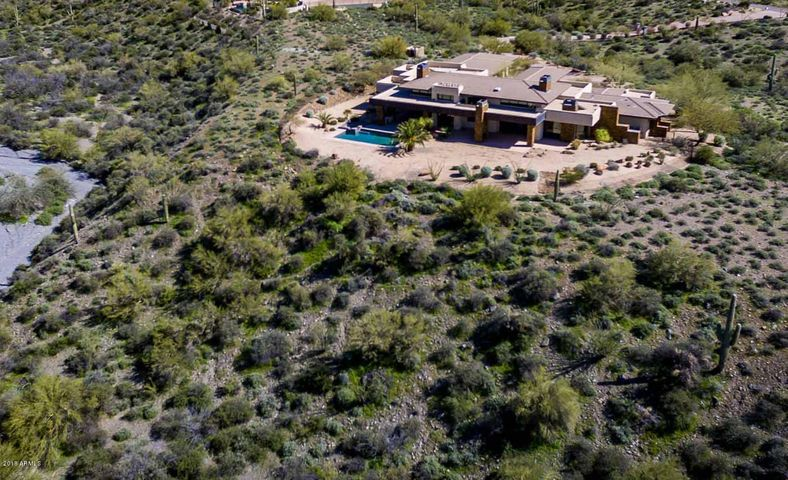 This contemporary home is sited on a high bluff to maximize the views you will enjoy!