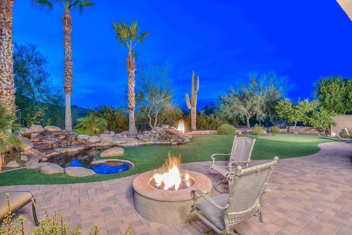 Extended Paver Patio, Firepit, Double Rock Waterfall, Synthetic Grass, & Putting Green