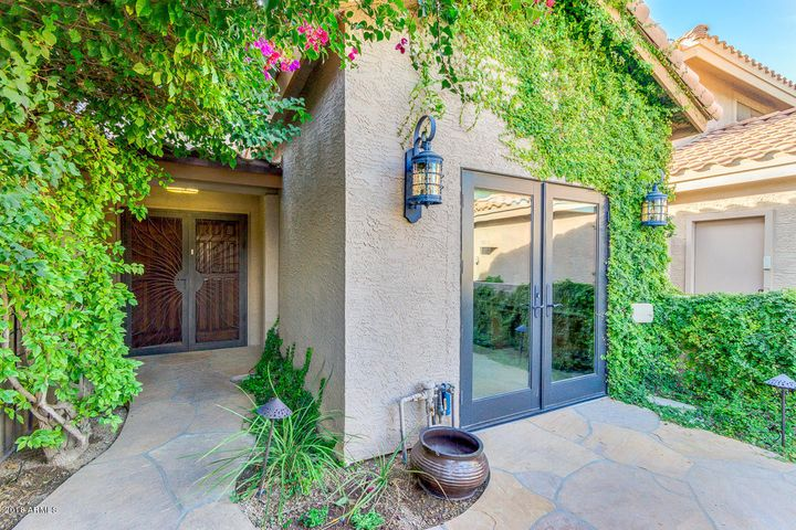 Beautiful entry into walled courtyard. Can't see the rock waterfall against the courtyard wall. French door enters 3rd bedroom.
