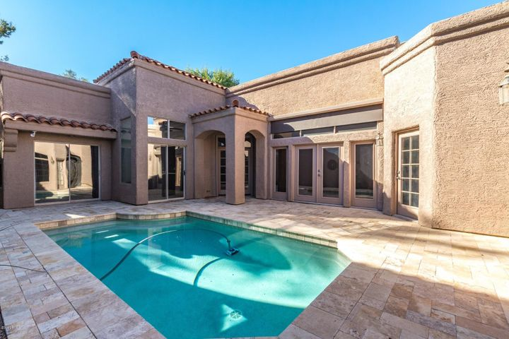 Entrance courtyard with heated pool and newer travertine pavers
