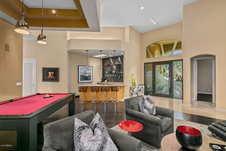 Living room offers space for a formal living/dining or more casual living with a billiard table.