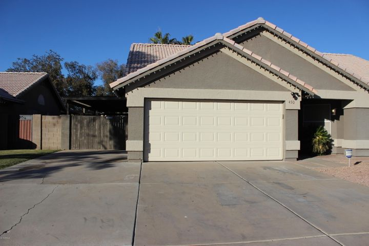 Front view of home-2 car garage, 3 car driveway, even a space next to the garage for a 4th vehicle.