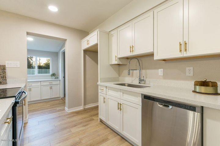 The gold hardware on the cabinets is a great touch that takes this kitchen up a notch!