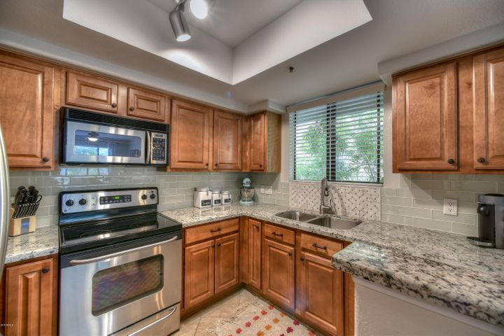 Beautiful granite counter tops, subway & decorative tile backsplash with stainless steel appliances!