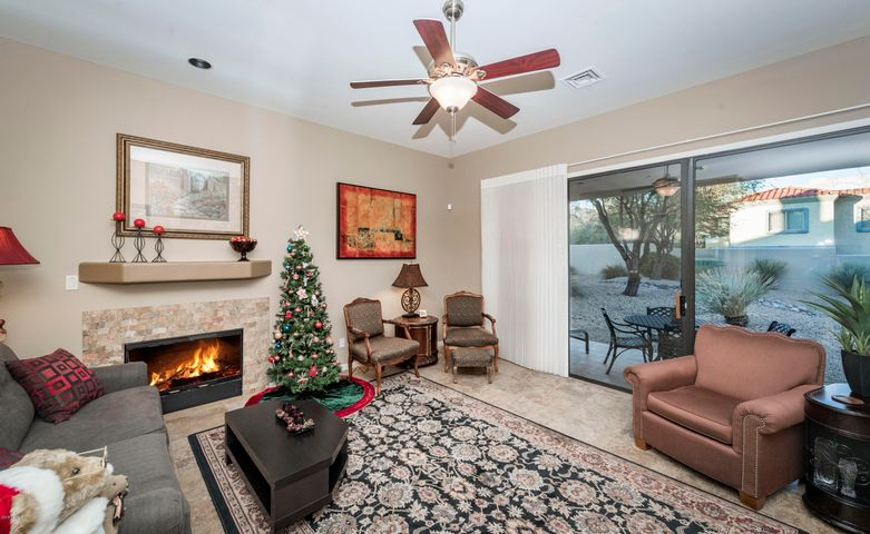 Cozy gas fireplace. Covered patio. No maintenance back yard.