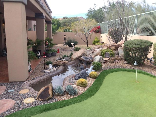 Reflecting pond, putting green, 300 sqft of covered ,tiled patio.