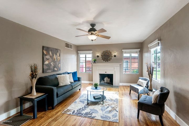 Spacious living room that has been meticulously maintained for almost a century!