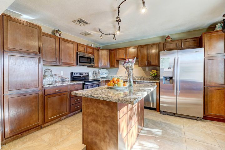 new kitchen cabinetry, marble countertop & serving island