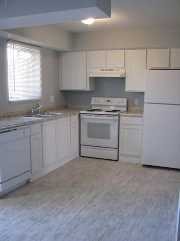 Beautiful new kitchen lower cabinets, counter tops and appliances.