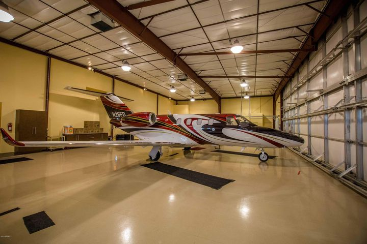 Plenty of room for jets, planes, car collectios, RV's, boats and toys in this mammoth hangar over 100 feet wide.