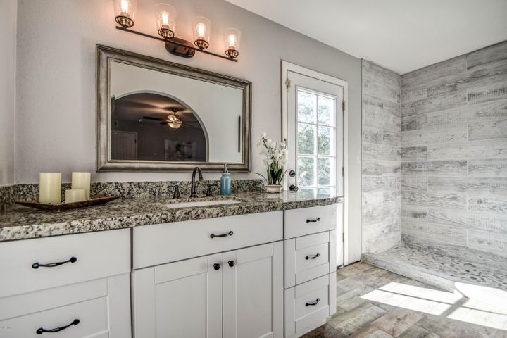 Master bathroom has new vanity & custom shower