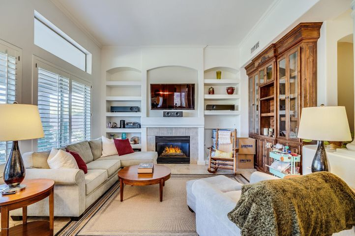 Very open with gas fireplace and custom built-ins.