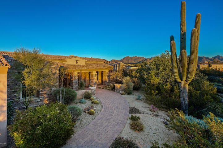 This single level custom home on 2.5 acres with a 4830 sf main house and 1354 sq guest house offer views and privacy.