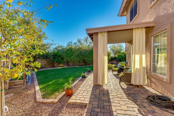 Mature landscaping for privacy, garden with peppers & grapevine, shade & citrus trees, 2 patios for entertaining, pavers.