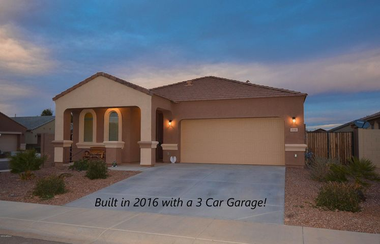 This 2016 home has a 3 car garage and is in a gated community