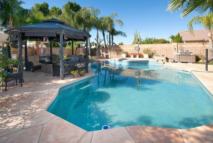 Resort style pool and gazebo.