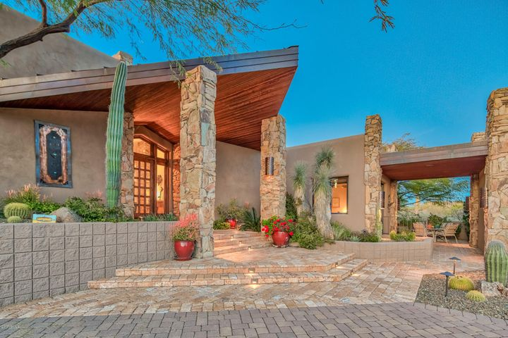 Beautiful front entry with wood beam ceiling and stone columns