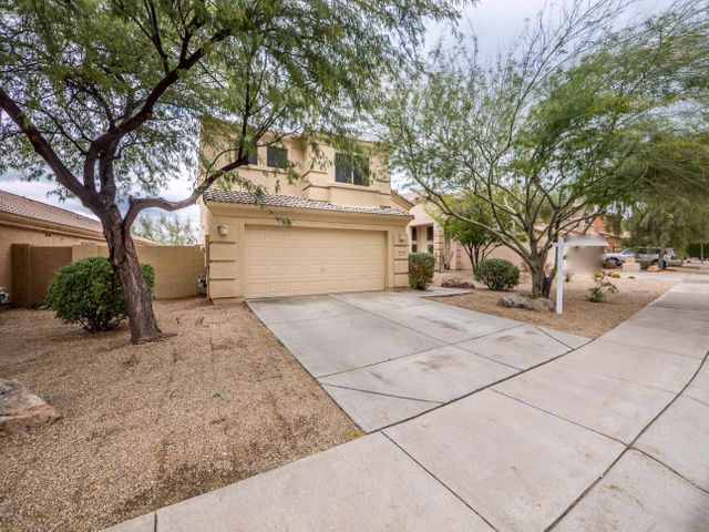Highly desirable Tatum Ranch 3 bed, 2.5 bath two story home situated on one of the best lots backing a natural desert wash for privacy and views!