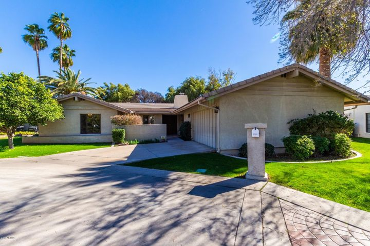 Beautiful, lush front yard. Home features private courtyard near front door. Perfect place to enjoy a cup of coffee in the morning.