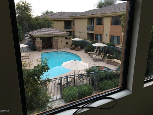 Premium Location overlooking the pool with south facing patio