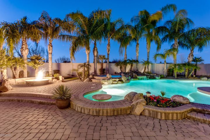 relax and enjoy your sit in pool table, jacuzzi, fire pit, North facing g, covered patio, outdoor kitchen home