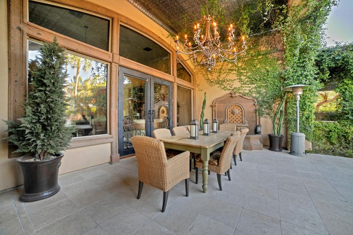 Spectacular outdoor dining area with tin ceiling & chandelier