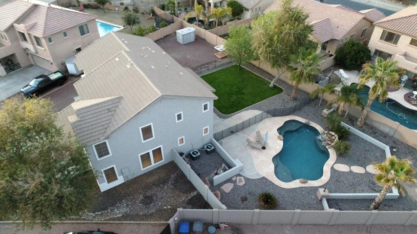 HUGE lot, amazing back yard with heated saltwater pool, and removable fence.