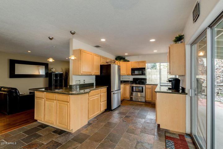 Spacious kitchen with granite countertops and stainless-steel appliances