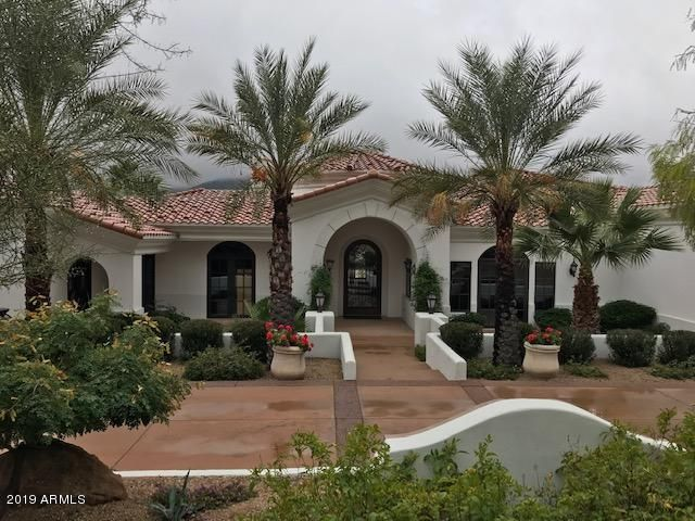 FRONT ENTRY VIEW OF HOME FROM THE MEDUSA STONE FOUNTAIN ON A RAINY DAY