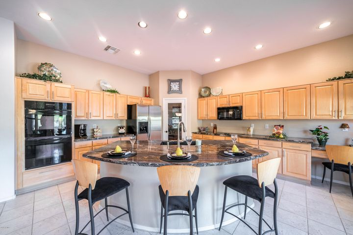 Very large kitchen with lots of cabinets and a walk in pantry.