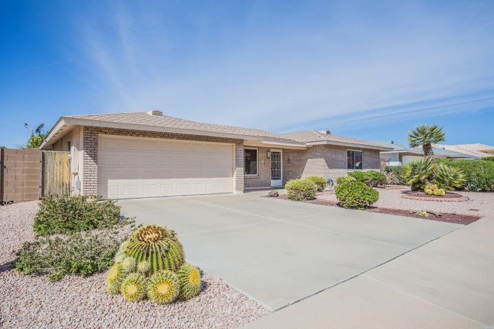 Beautiful curb appeal with a fantastic driveway leading to a spacious 2 car garage with storage cabinets!