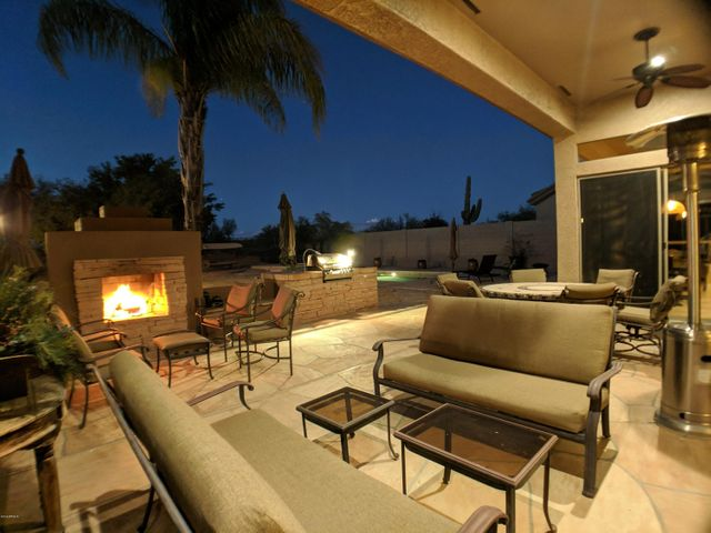 Great for entertaining, the large covered patio overlooks the outdoor fireplace, built-in barbeque and pool.