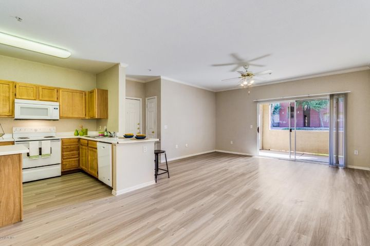 All new flooring and fresh paint. Ground floor condo overlooking grassy common area just steps to the pool.
