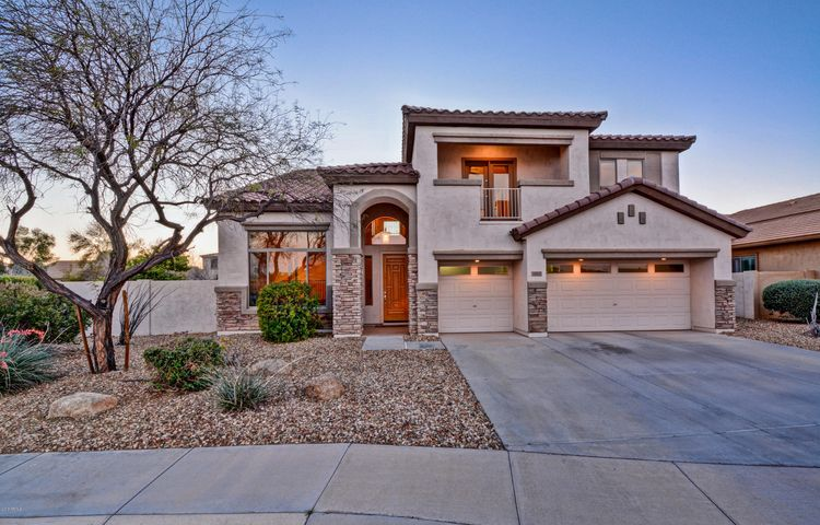 Beautiful home on oversized lot in desirable Surprise Farms community!