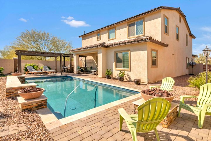 Sparkl8ing pool, built-in BBQ extensive paver patio, and gas fire place!!!! Enjoying outdoor living!